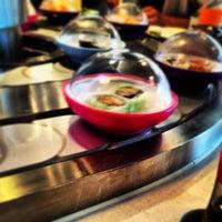 Photo taken at YO! Sushi by Rich U. on 6/8/2013