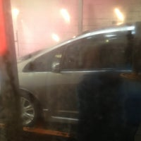 Photo taken at National City Car Wash by Adrian L. on 5/24/2013