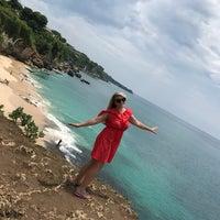 Photo taken at Tegal Wangi Beach by Anastasia V. on 10/28/2016