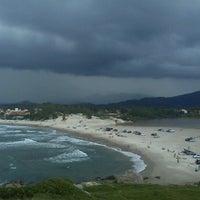 Photo taken at Praia da Ferrugem by Carla S. on 2/9/2013