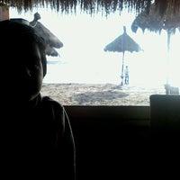 Photo taken at Tuto Beach by Jimena V. on 6/6/2013
