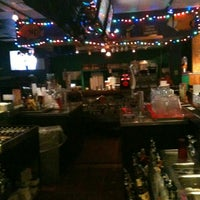 Photo taken at Checkered Parrot by Pam E. on 7/11/2013