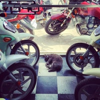 Photo taken at The Motorcycle Shop by Tito B. on 3/13/2014