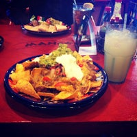 Photo taken at Mango's Taqueria and Cantina by Gloriana L. on 9/16/2012