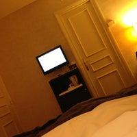 Photo taken at Hélios Ópera Hotel by Flavio M. on 1/11/2013