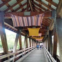 Photo taken at Littleton Riverwalk Bridge by Tammy S. on 6/11/2014