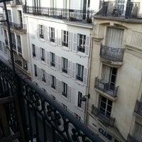 Photo taken at Hôtel Royal Magda Etoile by Widjaya on 3/15/2013