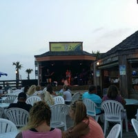 Photo taken at Ocean Annie's Beach Bar by Cynthia R. on 6/25/2015