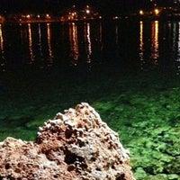 Photo taken at Vouliagmeni Beach by Miran on 7/27/2013