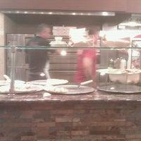 Photo taken at Delizia Pizza by Lisa U. on 9/14/2012