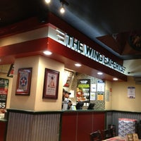 Photo taken at Wingstop by Donovan R. on 1/1/2013