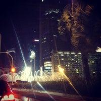 Photo taken at MH. Thamrin - Sudirman Street by Jennifer L. on 9/28/2013