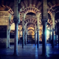 Photo taken at Mosque-Cathedral of Cordoba by Andrea M. on 5/22/2013