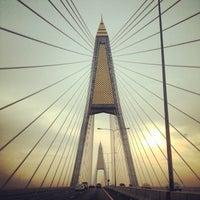 Photo taken at Bhumibol 1 Bridge by Nusara K. on 10/16/2013