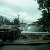 Photo taken at Ortigas & Greenmeadows Avenue Intersection by Mia B. on 11/9/2012