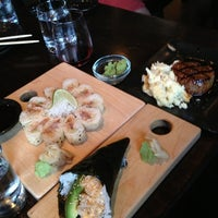 Photo taken at Sushi Dokku by Lucy T. on 8/10/2013