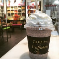 Photo taken at Godiva Chocolatier by Cesar Y. on 4/12/2015