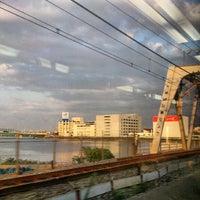 Photo taken at JR 下神崎川橋梁 by Izumi T. on 9/19/2012