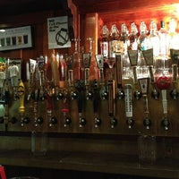 Photo taken at Rogue Ales Public House & Distillery by Chris W. on 6/24/2013