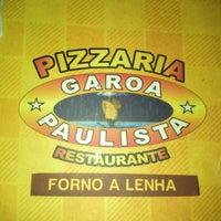 Photo taken at Pizzaria Garoa Paulista by Academia M. on 3/17/2013