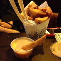 Photo taken at Pommes Frites by Timmy S. on 2/26/2013