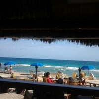 Photo taken at Bamboo Beach Tiki Bar & Cafe by D. on 12/24/2012