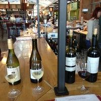 Photo taken at Oxbow Wine Merchant & Wine Bar by Erin C. on 7/16/2013