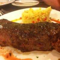 Photo taken at Restaurant La Rueda 1975 by Gutemberg M. on 10/21/2012