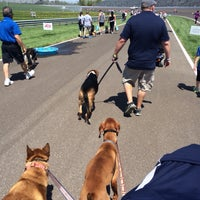 Photo taken at Mutt Strut @ IMS by Cara O. on 4/26/2014
