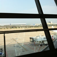 Photo taken at Gate D60 by Raoul H. on 9/10/2013