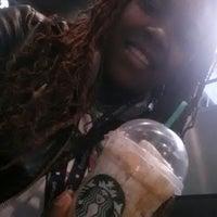 Photo taken at Starbucks by Tangela L. on 4/10/2013