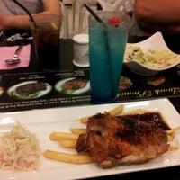 Photo taken at Cafe Indulge by Lim C. on 11/19/2012