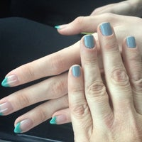 Photo taken at Elegant Nails by Michelle G. on 3/21/2015