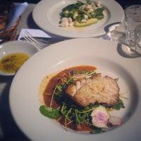 Photo taken at Justine's Brasserie by Mina A. on 3/15/2013