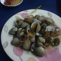 """Photo taken at Sea Food """"Do'a Ibu"""" by Qatrinnadya P. on 1/4/2014"""