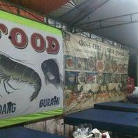 """Photo taken at Sea Food """"Do'a Ibu"""" by Qatrinnadya P. on 12/25/2012"""