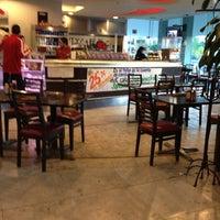 Photo taken at City Cafe by Oswaldo M. on 12/10/2012
