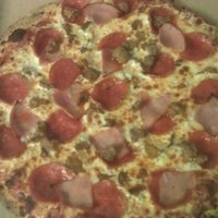 Photo taken at Naked Pizza by Christopher R. on 7/4/2013