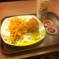 Photo taken at Lotteria by Oh Y. on 12/31/2014