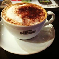 Photo taken at Caffè Nero by Asude on 3/15/2013