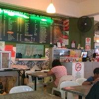 Photo taken at Ket's Kitchen by Zahrain M. on 10/14/2012