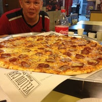 Photo taken at Yellow Cab Pizza Co. by Kerwin M. on 6/30/2014