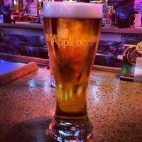 Photo taken at Applebee's Neighborhood Grill & Bar by Michaela B. on 12/17/2012