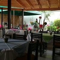 Photo taken at Café del Pueblo by Josefina R. on 10/22/2014