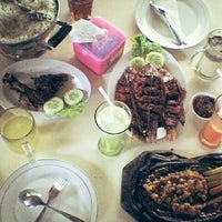 Photo taken at Papringan Resto by Rizky K. on 5/1/2014