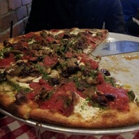 Photo taken at Grimaldi's Coal Brick-Oven Pizzeria by Neema E. on 4/28/2013