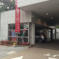 Photo taken at 日産プリンス東京販売 足立店 by n.waka on 5/25/2013