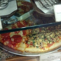 Photo taken at Cugini Pizzeria & Restaurant by Russ L. on 10/6/2013