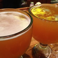Photo taken at Macado's Restaurant & Bar by Homer M. on 5/21/2013