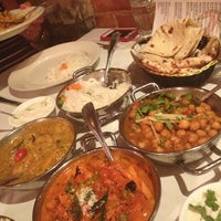 Photo taken at Brick Lane Curry House by Elisa A. on 7/28/2013